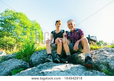 Hiking Seniors Taking a Break at the top of a mountain