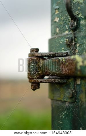 Rusty hinges on an old cart in the rain