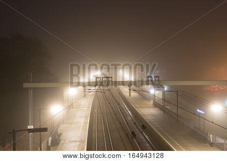 Train station in Halfweg during a foggy morning