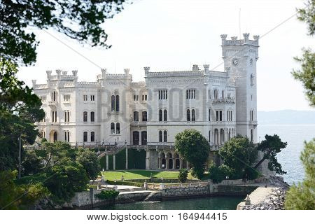 View of Miramare Castle in Trieste with park. (Italy) It was built for Austrian Archduke Ferdinand Maximilian.