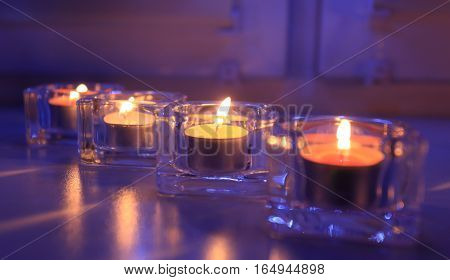 Candles on window sill in the evening. Candles at night. Beautiful valentine day background.