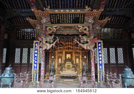 Shenyang Imperial Palace (Mukden Palace) Throne of Chongzheng Hall, Shenyang, Liaoning Province, China. Shenyang Imperial Palace is UNESCO world heritage site built in 400 years ago.