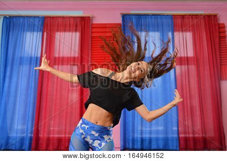 young beauty happy woman dancing having fun with wind in hair .
