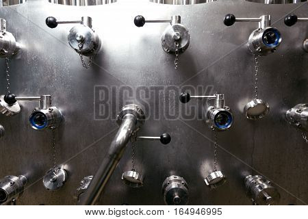 Good in usage. Close up of pipes and regulators standing and being used in brewery