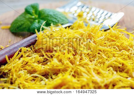 Zest Of Lemon And Grater With Wooden Handle.