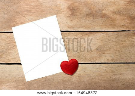 A sheet of paper with a heart not a wooden background