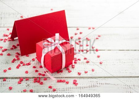 Valentines day background. Postcard confession of love. Red greeting card and gift.