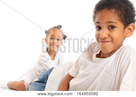 mixed-race brother and sister playing on the floor