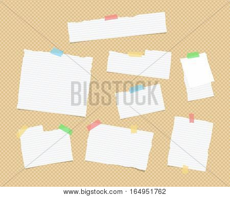 Ripped white ruled note, notebook, copybook paper sheets, strips stuck with colorful sticky tape on brown squared pattern.