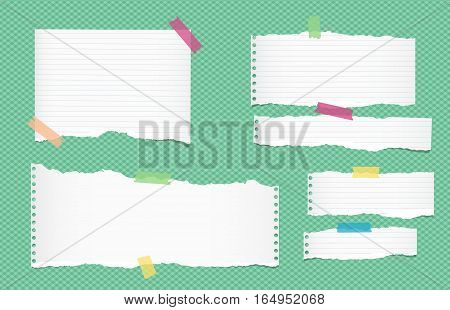 Ripped white ruled note, notebook, copybook paper sheets, strips stuck with colorful sticky tape on green squared pattern.