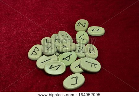 runes for fortunetelling on a red background