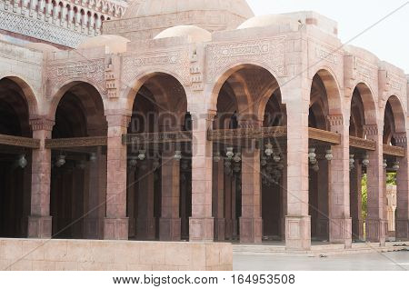 View of the tower of the ancient mosque. Mosque entrance ornament. Islamic ornaments on wall. Arab symbols. Al Mustafa Mosque Sharm El Sheikh. Ancient wall