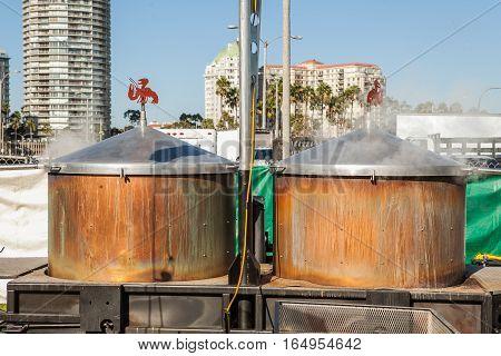 Huge street pots for boiling lobsters on a food lobster festival