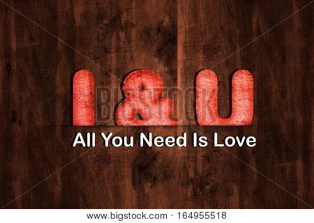 Dark Brown wood texture background with wood Text I & U with text all you need is love. Valentine day