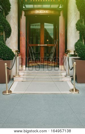 Five star hotel entrance with golden red bars and beautiful vintage door