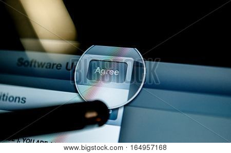 PARIS, FRANCE - SEP 14, 2014: Stylus pressing Agree button on technological interface on a tablet phone computer screen