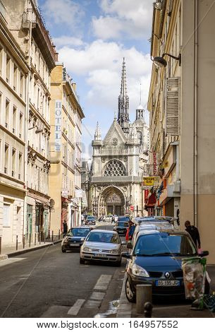 PARIS FRANCE - AUG 18 2014: Eglise Saint-Laurent Church on boulevard de Magenta avenue in central paris with beautiful French architecture pedestrians and cars on a warm working day