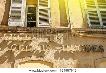 AIX-EN-PROVENCE FRANCE - JUL 17 2014: Facade letter on the main building of Lyceum TV Clovis Hugues in center of Aix En Provence