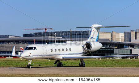 Kloten, Switzerland - 30 September, 2016: a Gulfstream V jet in the Zurich Airport. Zurich Airport, also known as Kloten Airport, is the largest international airport of Switzerland and the principal hub of Swiss International Air Lines.