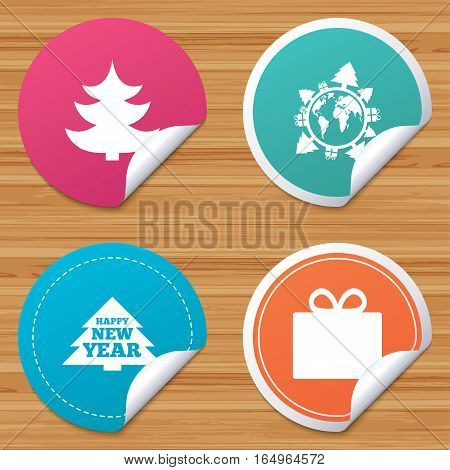 Round stickers or website banners. Happy new year icon. Christmas trees and gift box signs. World globe symbol. Circle badges with bended corner. Vector