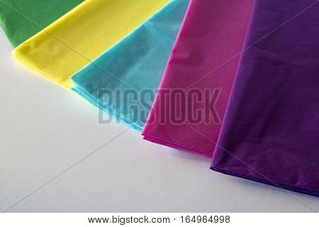 Tissue paper samples in spring colors with copyspace.