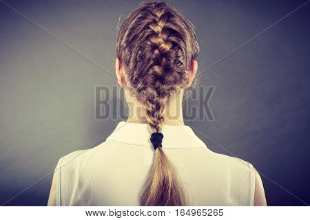 Back View Of Woman With Blonde Braid.
