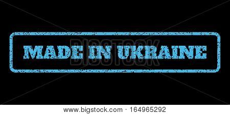 Light Blue rubber seal stamp with Made In Ukraine text. Vector caption inside rounded rectangular banner. Grunge design and dust texture for watermark labels. Horisontal sticker on a black background.