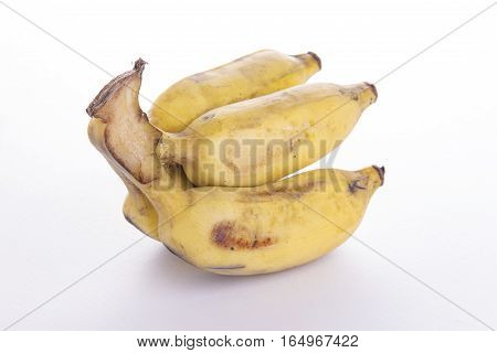 view of small cutting of hand of ripe Pisang Awak banana on white background poster