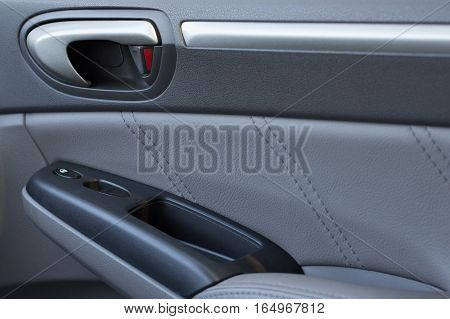 Vehicle Door Locked with Some Leather Panelling