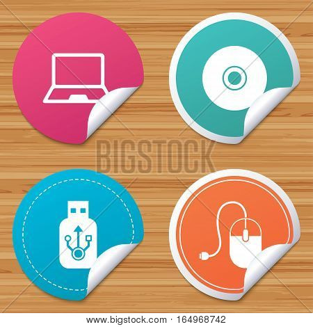 Round stickers or website banners. Notebook pc and Usb flash drive stick icons. Computer mouse and CD or DVD sign symbols. Circle badges with bended corner. Vector