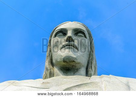 RIO DE JANEIRO, BRAZIL - JANUARY 07, 2017: Head of Christ the Redeemer on the background of blue sky