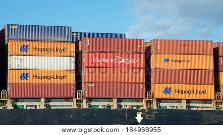 Oakland CA - January 01 2017: Shipping containers are organized and placed algorithmically for efficient transport. Most modern container ships can carry up to 16020 twenty-foot equivalent units.