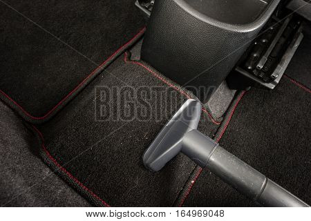 cleaning the car with vacuum cleaner, car care concept