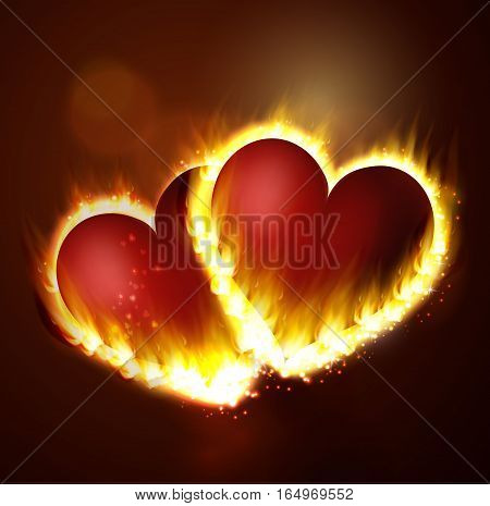 Flame in two hearts burning on the dark background pink and red