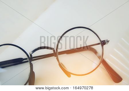 Artwork in retro style Spectacles and book vintage styled