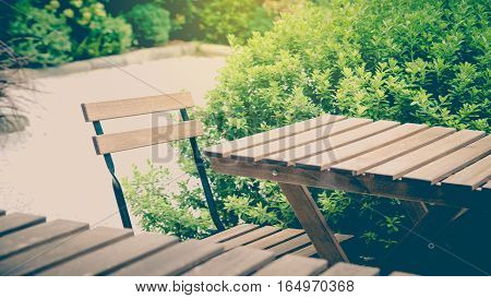 Garden table and chairs. vintage sunlight effect