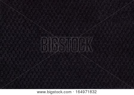 Black background from soft fleecy fabric closeup. Texture of textiles macro.