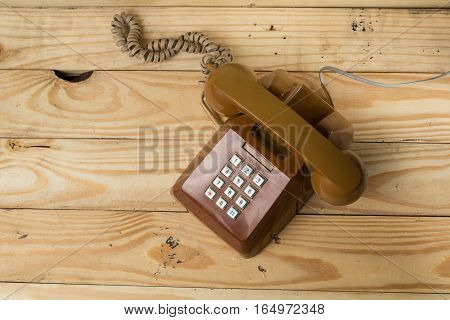 Old phone retro Placed on a wooden floor