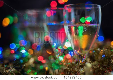 Christmas, New Year Background With Sparkling Wine And Shiny Bokeh
