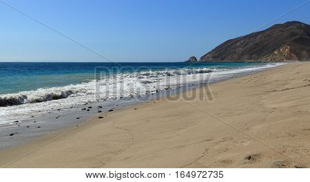Looking northwest along the shore at Thornhill Broome Beach, Malibu, California.