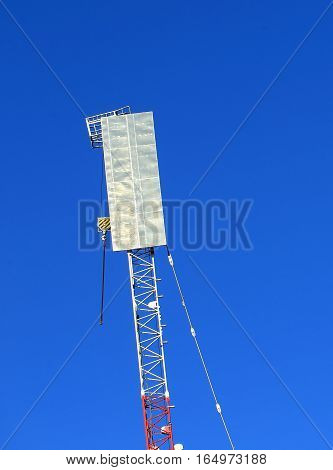 Girder of the crane with work platform and a reflector