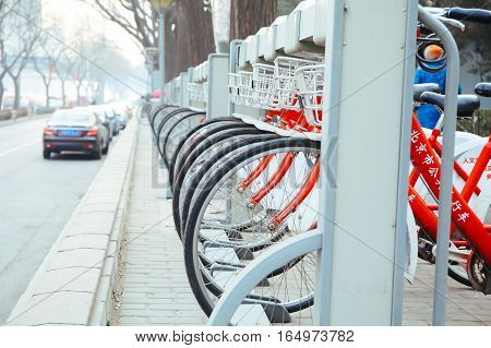 BEIJINGCHINA 6 JANUARY 2017: Public Bike Rental Station in Beijing China with Bicycles arranging in row ready for public rental