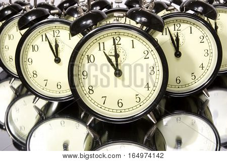 A group of retro alarm clocks isolated on white.