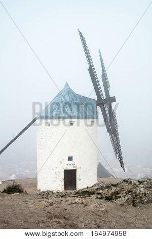 A windmill in a thick fog in Castilla-La Mancha, Spain