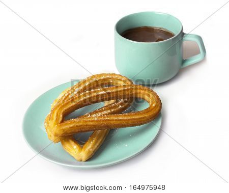 Photo of churros - traditional Spanish, especially Madrid, dessert, in particular for Sunday breakfast. In form of horseshoes, with cup of hot chocolate, on white background