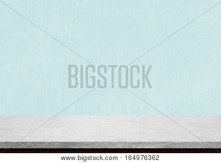 Empty stone table top on blue concrete background Used for display or montage your products.