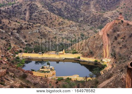 Defensive Wall And Water Reservoir Of Jaigarh Fort On Aravalli Hills Near Jaipur, Rajasthan, India