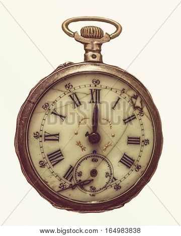 Antique decayed pocket watch isolated on white background, top view.