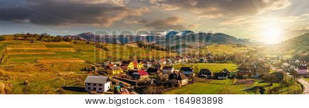 Panorama Of Rural Area In Mountains At Sunset