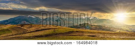 Panorama Of Rural Fields In Mountains At Sunset
